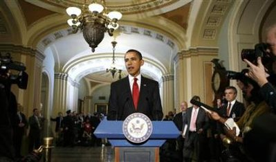 President Barack Obama speaks to reporters during his visit to the Capitol in Washington January 27, 2009.