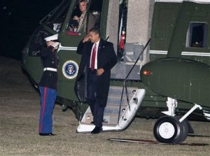 President Barack Obama arrives on the South Lawn of the White House in Washington, Thursday, Feb. 5, 2009. (AP Photo/Gerald Herbert)