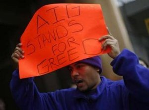A protestor takes part in a rally in front of an American International Group (AIG) office calling on Congress to take action on employee free choice, health care, and banking reform in Washington, March 19, 2009. REUTERS/Jim Young