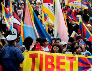 Free Tibet activists march during a peace march rally in Tokyo, Japan, Saturday, March 14, 2009. The rally marks the 50th anniversary of the failed uprising against the Chinese rule in their homeland. (AP Photo/Itsuo Inouye)