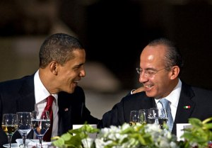 President Obama talks with Mexican President Felipe Calderón during a banquet at the Anthropology Museum in Mexico City. April 16, 2009 (Ronaldo Schemidt / AFP/Getty Images)