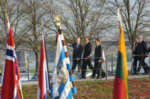 "NATO Secretary Jaap de Hoop Scheffer, Barack H. Obama, President of the United States of America, Nicolas Sarkozy, President of France, and Angela Merkel, Chancellor of the Federal Republic of Germany (hidden by Sarkozy) crossing the ""Passerelle de deux rives"" from Germany into France (NATO photo, 4 April 2009)"