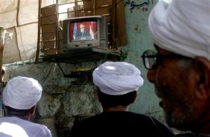 Egyptian villagers watch a live broadcast of a speech by U.S. President Barack Obama is seen on screen at a coffee shop in Qena, south Cairo, Egypt, Thursday, June 4, 2009. Obama was calling for a new beginning between the United States and Muslims, during his speech delivered at Cairo University in Egypt. (AP Photo)
