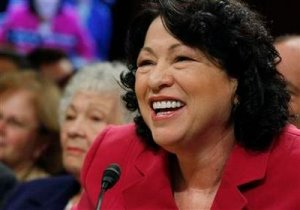 U.S. Supreme Court nominee Judge Sonia Sotomayor smiles while answering questions during her fourth and final day of testimony at her U.S. Senate Judiciary Committee confirmation hearings as her mother Celina Sotomayor (L) listens on Capitol Hill in Washington July 16, 2009.   REUTERS/Jason Reed