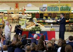 President Barack Obama arrives at a town hall meeting on health care in a Kroger supermarket in Bristol, Va., Wednesday, July 29, 2009.  (AP Photo/Steve Helber)